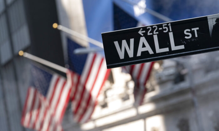 A sign for Wall Street hangs in front of the New York Stock Exchange on July 8, 2021. (Mark Lennihan/AP Photo)