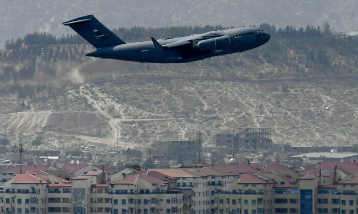 An US Air Force aircraft takes off from the airport in Kabul on Aug. 30, 2021. Rockets were fired at Kabul's airport on Aug. 30 where U.S. troops were racing to complete their withdrawal from Afghanistan and evacuate allies under the threat of attacks from ISIS terrorists. (Aamir Qureshi/AFP via Getty Images)