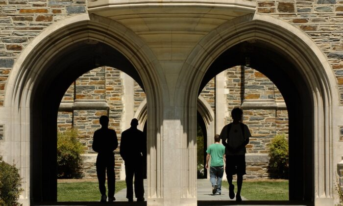 In this file photo taken in 2006, students pass under the arches at Duke University in Durham, North Carolina. (Sara D. Davis/Getty Images)