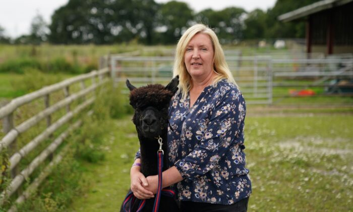 Geronimo the alpaca, with his owner Helen, in this undated picture from a farm near Wickwar, South Gloucestershire, England. (PA)