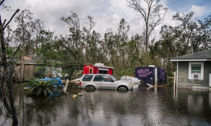 A vehicle and houses sit in floodwater in Barataria, La., on Aug. 31, 2021. (Brandon Bell/Getty Images)