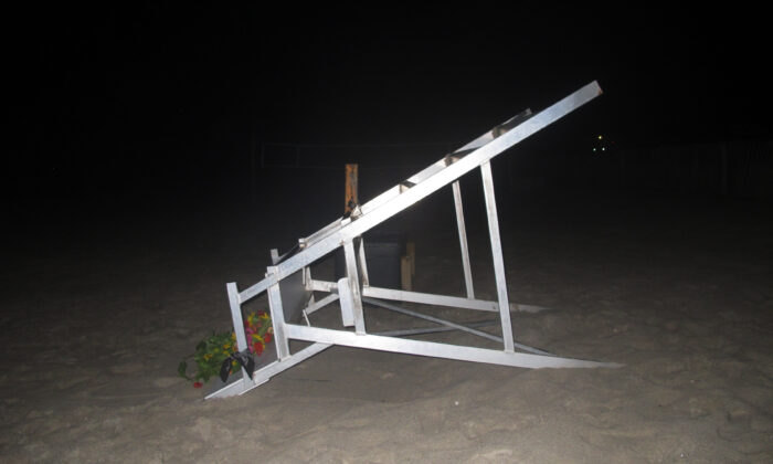A lifeguard chair sits overturned on the sand at the beach where a young lifeguard was killed and seven others injured by a lightning strike in Berkeley Township, N.J., on Aug. 30, 2021. (Wayne Parry/AP Photo)