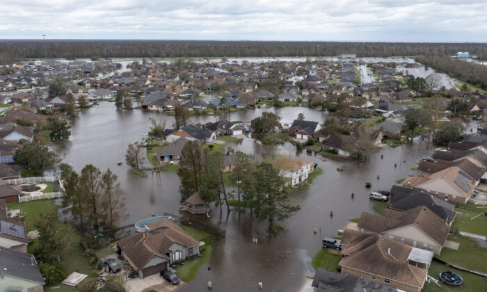 Flooded streets and homes are shown in the Spring Meadow subdivision after Hurricane Ida moved through in LaPlace, La., on Aug. 30, 2021. (Steve Helber/AP Photo)