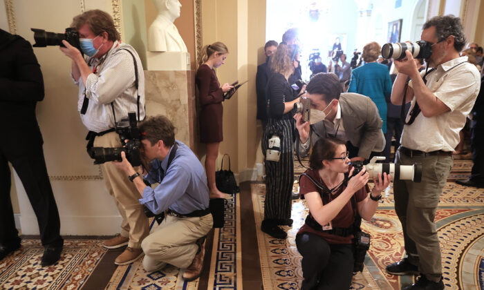 Photographers take pictures in the U.S. Capitol on July 20, 2021. (Chip Somodevilla/Getty Images)