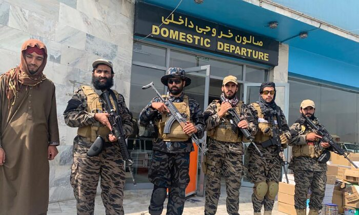 Taliban extremists stand guard inside the Hamid Karzai International Airport after the U.S. withdrawal in Kabul, Afghanistan on Aug. 31, 2021. (Kathy Gannon/AP Photo)