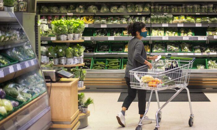 A shopper in a supermarket in east London, UK, on July 24, 2020. (Victoria Jones/PA)