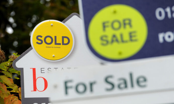 Signs of sold and for sale in an undated file photo, on Oct 14, 2014. (Andrew Matthews/PA)
