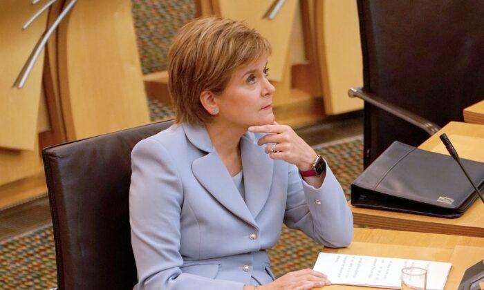 First Minister Nicola Sturgeon speaking in the Scottish Parliament, Edinburgh, UK, on Sept. 1, 2021. (Andrew Milligan/PA)