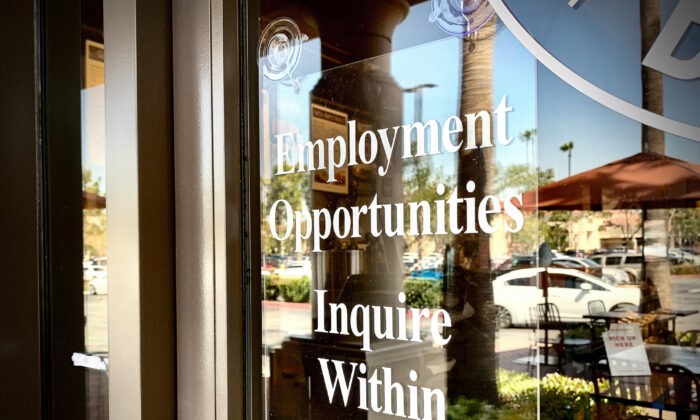 A sign displaying employment opportunities hangs near the doorway of a business in Irvine, Calif., on March 23, 2021. (John Fredricks/The Epoch Times)