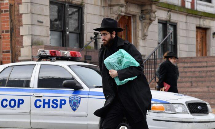 An Orthodox Jewish man walks in the Brooklyn neighborhood of Crown Heights in New York on Feb. 27, 2019. (Angela Weiss/AFP via Getty Images)