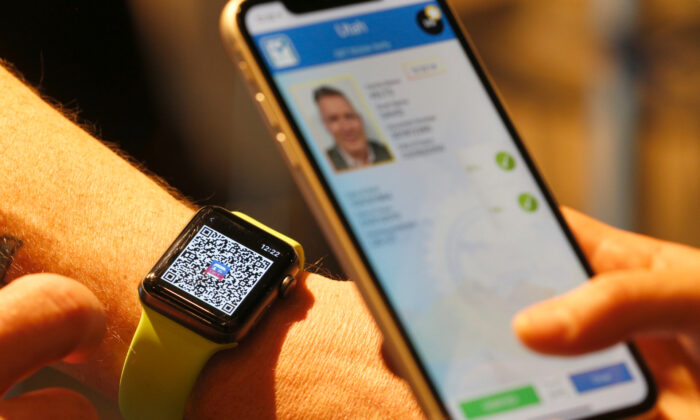 A person scans a QR code on an Apple Watch to temporarily send their digital driver's license to another mobile phone at a Harmons Grocery store in Salt Lake City, Utah on Aug. 4, 2021. (George Frey/Getty Images)