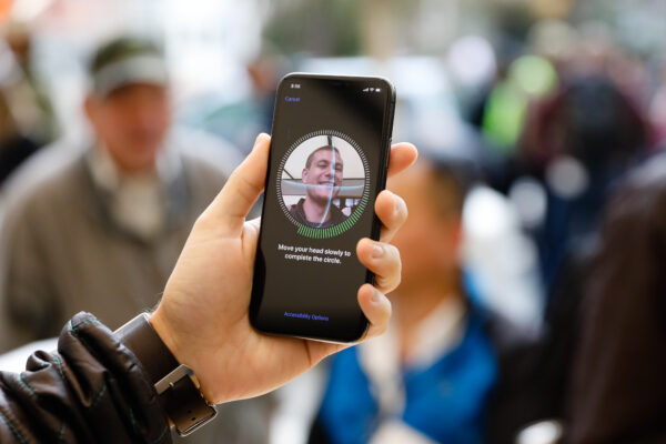 A customer sets up Face ID on his new iPhone X at the Apple Store Union Square on November 3, 2017, in San Francisco, California. Apple's flagship iPhone X hits stores around the world as the company predicts bumper sales despite the handset's eye-watering price tag, and celebrates a surge in profits. / AFP PHOTO / Elijah Nouvelage (Photo credit should read ELIJAH NOUVELAGE/AFP via Getty Images)