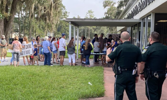 Citizens line up to attend the emergency school board meeting regarding a proposed mask mandate for children in Hernando, County, Fla, on Aug. 31, 2021. (Patricia Tolson/The Epoch Times)