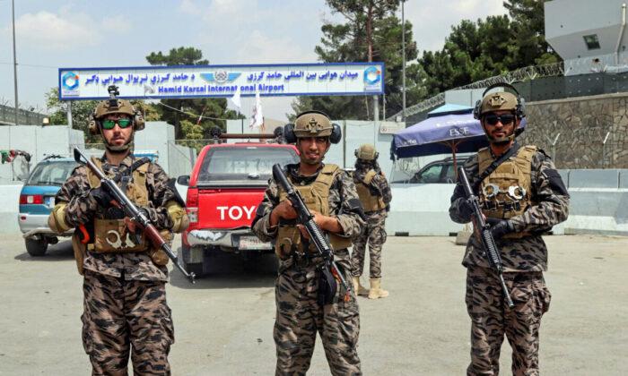 Taliban terrorists stand guard outside the Hamid Karzai International Airport after the U.S. military's withdrawal, in Kabul, Afghanistan, on Aug. 31, 2021. (Khwaja Tawfiq Sediqi/AP Photo)