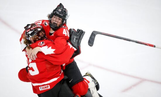 Poulin Scores in Overtime, Canada Wins First World Title Since 2012