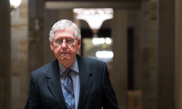 Senate Minority Leader Mitch McConnell (R-Ky.) heads toward the Senate Chamber in the U.S. Capitol in Washington on Aug. 11, 2021. (Liz Lynch/Getty Images)