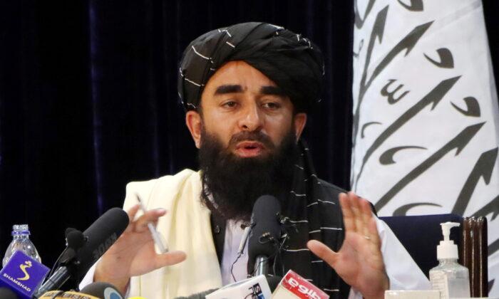 Taliban spokesman Zabihullah Mujahid speaks during a news conference in Kabul, Afghanistan on Aug. 17, 2021. (Stringer/Reuters)