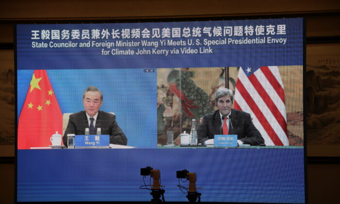 U.S. Special Presidential Envoy for Climate John Kerry is seen on a screen with Chinese State Councillor and Foreign Minister Wang Yi during a meeting via video link on Sept. 1, 2021. (U.S. Department of State/Handout via Reuters)