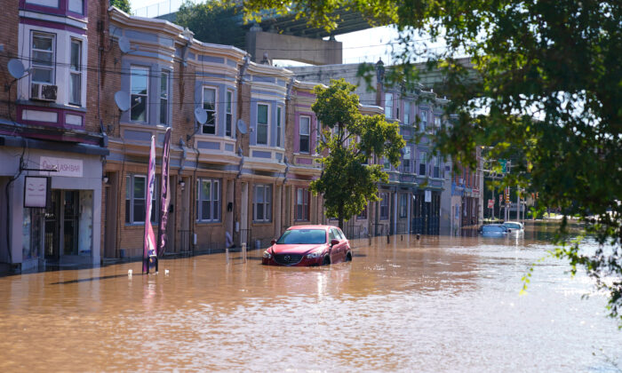A street is flooded as the Schuylkill River exceeds its bank in the East Falls section of Philadelphia, on Sept. 2, 2021, in the aftermath of downpours and high winds from the remnants of Hurricane Ida that hit the area. (AP Photo/Matt Rourke)