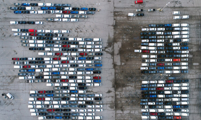 Mid-sized pickup trucks and full-size vans are seen in a parking lot outside a General Motors assembly plant where they are produced in Wentzville, Mo, on March 24, 2021. (Jeff Roberson/AP Photo)