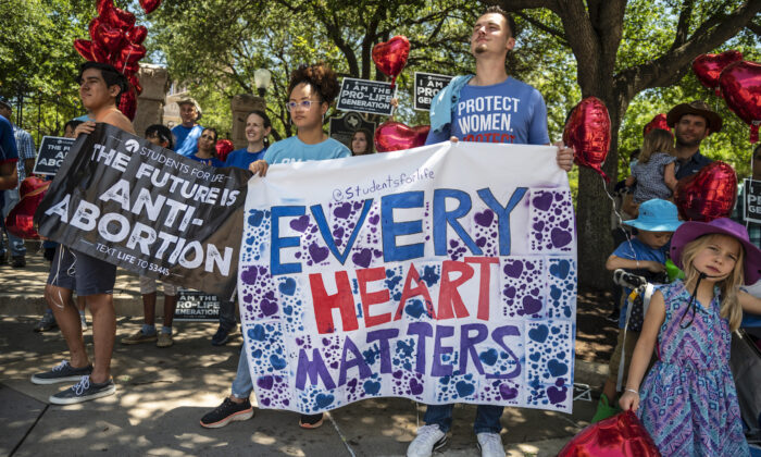 Pro-life protesters stand near the gate of the Texas state capitol on May 29, 2021. (Sergio Flores/Getty Images)