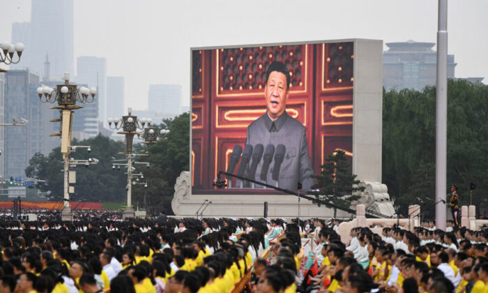 Chinese leader Xi Jinping (on screen) delivers a speech during the celebrations of the 100th anniversary of the founding of the Communist Party of China at Tiananmen Square in Beijing on July 1, 2021. (Wang Zhao/AFP via Getty Images)
