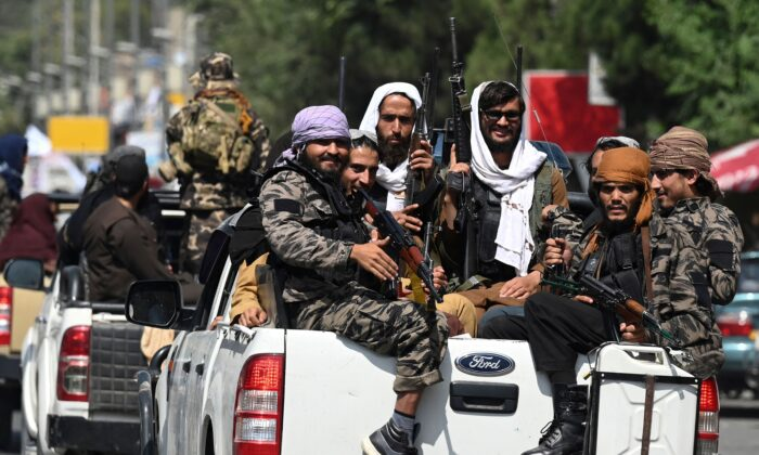 A convoy of Taliban fighters patrol along a street in Kabul on Sept. 2, 2021. (Aamir Qureshi/AFP via Getty Images)