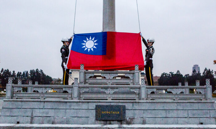 Honor guards prepare to raise the Taiwan flag in the Chiang Kai-shek Memorial Hall square in Taipei, Taiwan, on Jan. 14, 2016. (Ulet Ifansasti/Getty Images)