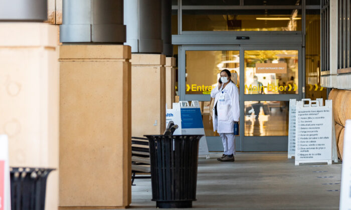 Healthcare workers at St. Joseph Hospital in Orange, Calif., on Dec. 16, 2020. (John Fredricks/The Epoch Times)