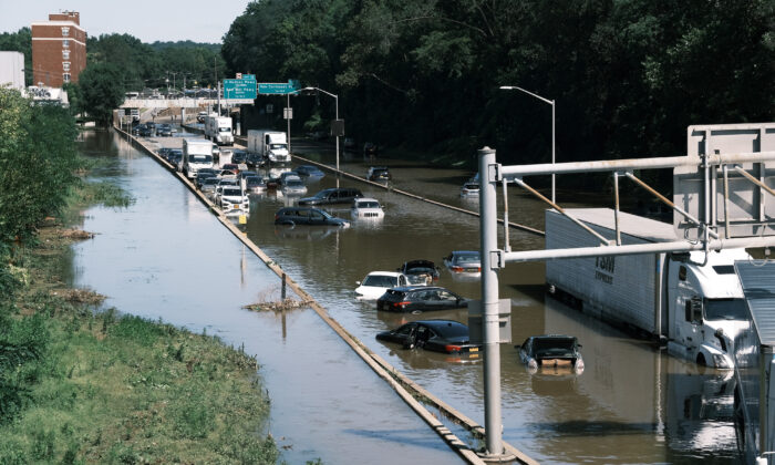 Cars sit abandoned on the flooded Major Deegan Expressway in the Bronx following a night of heavy wind and rain from the remnants of Hurricane Ida in New York on Sept. 2, 2021. (Spencer Platt/Getty Images)