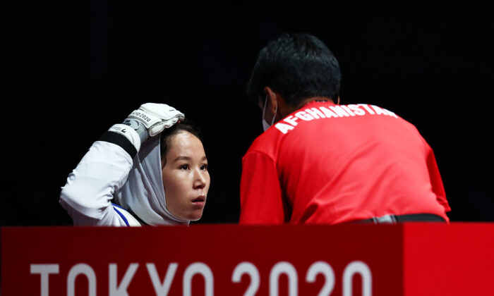 Zakia Khudadadi of Afghanistan during her bout against Viktoriia Marchuk of Ukraine at Tokyo 2020 Paralympic Games in Chiba, Japan, on Sept. 2, 2021. (Thomas Peter/Reuters)