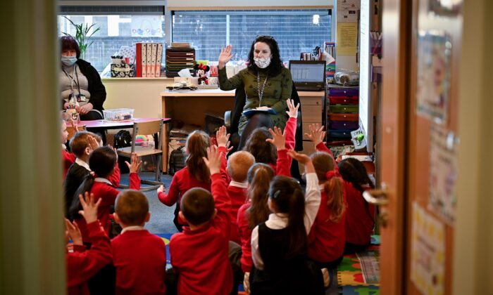 Pupils return to the classroom at Cleeves Primary School, in Glasgow, Scotland, on Feb. 22, 2021. (Jeff J Mitchell/Getty Images)