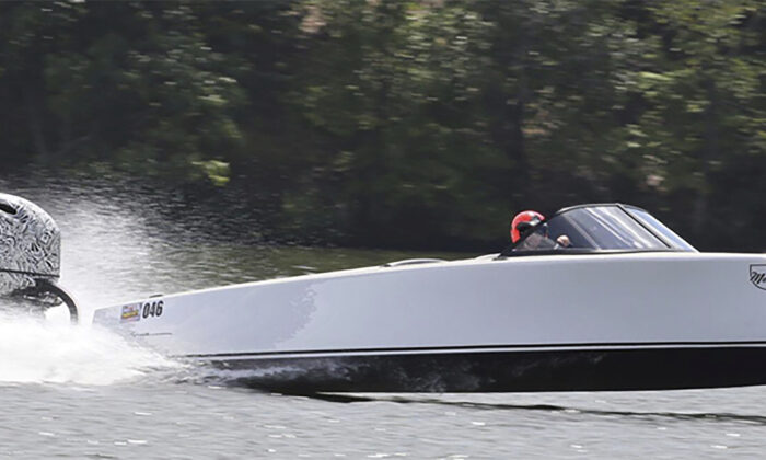 The Vision Marine Technologies' Vision Marine Bruce 22 boat with one of their E-Motion motors. The electric boat is capable of reaching speeds of 49 mph. (Jeff Helmkamp/LakeExpo via AP)