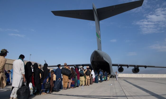 In this handout provided by U.S. Central Command Public Affairs, passengers board a U.S. Air Force C-17 as part of the evacuation from Afghanistan, at Hamid Karzai International Airport in Kabul, Afghanistan, on Aug. 24, 2021. (Master Sgt. Donald R. Allen/U.S. Air Forces Europe-Africa via Getty Images)