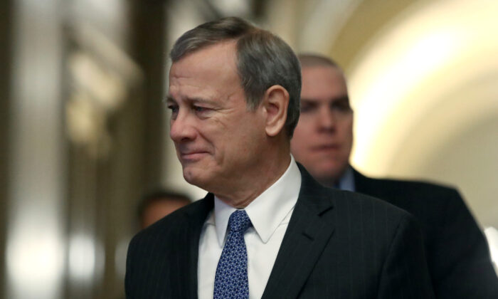 Supreme Court Justice John Roberts arrives at the U.S. Capitol in Washington on Jan. 31, 2020. (Mark Wilson/Getty Images)