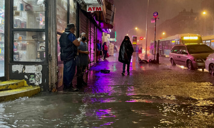People make their way in rainfall from the remnants of Hurricane Ida in the Bronx borough of New York City on Sept. 1, 2021. (David Dee Delgado/Getty Images)