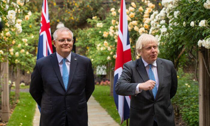 Prime Minister Boris Johnson with Australian Prime Minister Scott Morrison in the garden of 10 Downing Street, London, UK, on June 15, 2021. (Dominic Lipinski/PA)