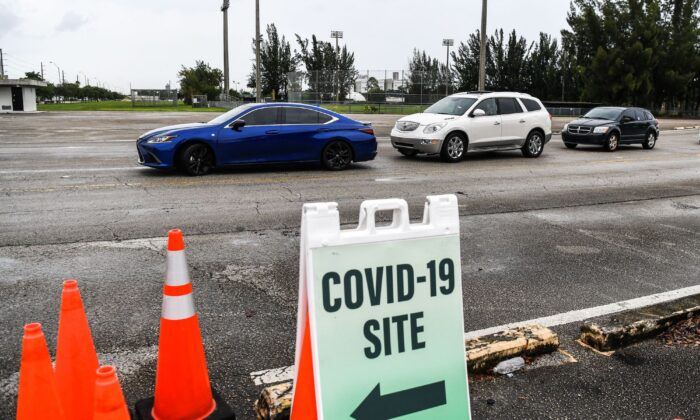 Cars line up for COVID-19 testing in Miami, Fla., on Aug. 3, 2020. (CHANDAN KHANNA/AFP via Getty Images)