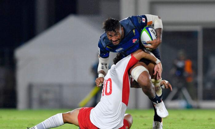 Amanaki Lelei Mafi of Japan being tackled by Latiume Fosita of Tonga during the Pacific Nations Cup match between Japan and Tonga at Hanazono Rugby Staidum in Higashiosaka, Osaka, Japan, on Aug. 3, 2019. (Koki Nagahama/Getty Images)