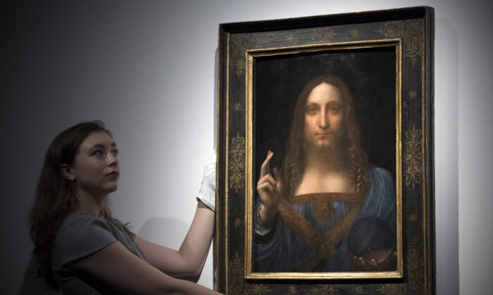 """Christie's previews Leonardo da Vinci's """"Salvator Mundi""""at Christie's on Oct. 24, 2017, in London before itis auctioned in New York on Nov. 15. (Carl Court/Getty Images)"""