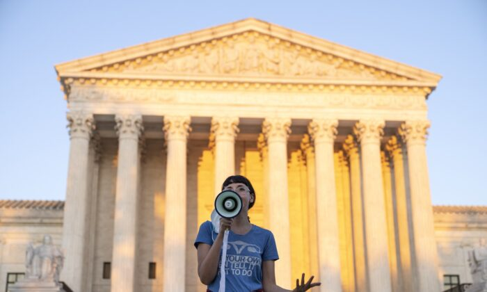 An activist speaks outside the Supreme Court in protest against the new Texas abortion law in Washington on Sept. 2, 2021. (Drew Angerer/Getty Images)