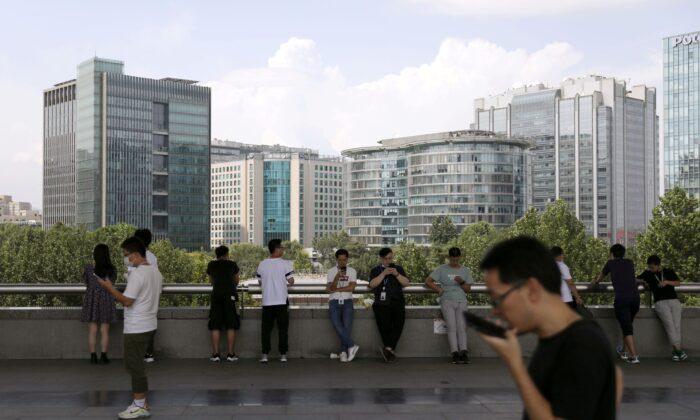 People are seen at Beijing's tech hub Zhongguancun, China, on Aug. 23, 2021. (Tingshu Wang/File Photo/Reuters)