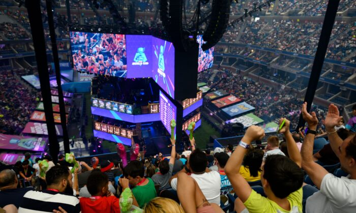 Fans cheer during the final of the Solo competition at the 2019 Fortnite World Cup inside of Arthur Ashe Stadium, in New York on July 28, 2019. (Johannes Eisele/AFP via Getty Images)