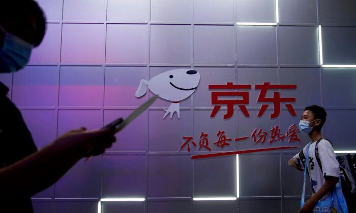 A sign of JD.com is seen at the China Digital Entertainment Expo and Conference, also known as ChinaJoy, in Shanghai, China, on July 30, 2021. (Aly Song/Reuters)