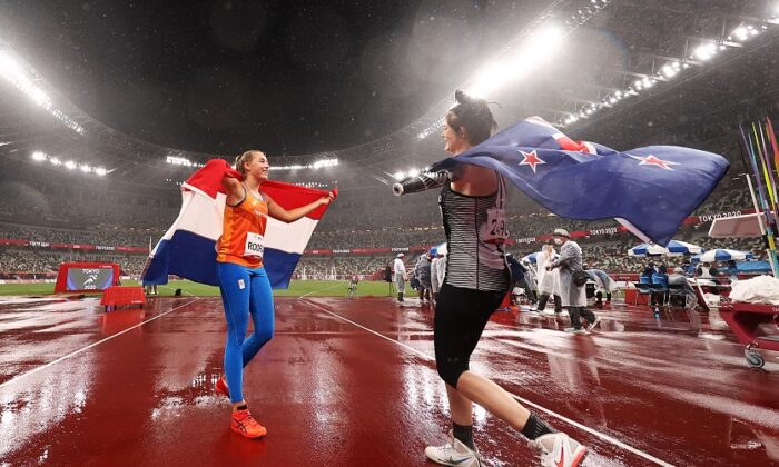 Silver medalist Noelle Roorda (L) of Team Netherlands celebrates with gold medalist Holly Robinson of Team New Zealand following the Women's Javelin Throw at the Tokyo 2020 Paralympic Games at the Olympic Stadium in Tokyo, Japan, on Sept. 3, 2021. (Dean Mouhtaropoulos/Getty Images)
