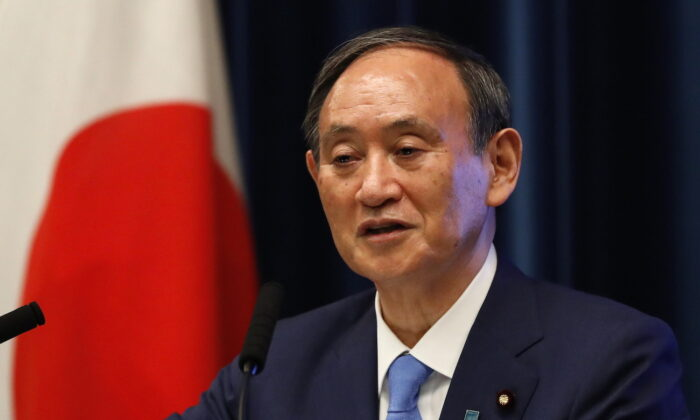 Japan's Prime Minister Yoshihide Suga attends a news conference at his official residence in Tokyo, Japan, on June 17, 2021. (Issei Kato/POOL/Getty Images)