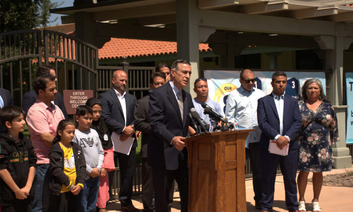 Congressman Darrell Issa and other groups jointly held a press conference to address the experiences of rescuing families of students trapped in Afghanistan in the Cajon Valley Unified School District in El Cajon, Calif., on Sept. 2, 2021. (Jane Yang/The Epoch Times)
