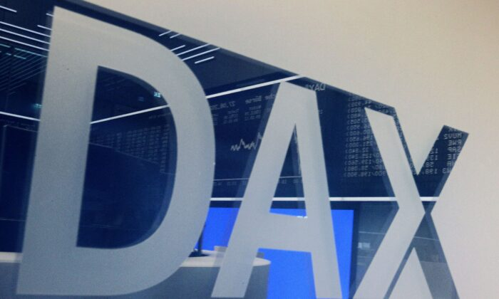 A board displaying the chart of Germany's share index DAX reflects in a window with the DAX logo at the stock exchange in Frankfurt am Main, western Germany on Aug. 27, 2021. (Daniel Roland/AFP via Getty Images)