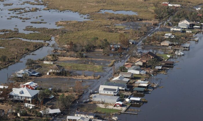 A view of flood damaged buildings is seen as President Joe Biden (not pictured) inspects the damage from Hurricane Ida on the Marine One helicopter during an aerial tour of communities in Laffite, Grand Isle, Port Fourchon, and Lafourche Parish, La., on Sept. 3, 2021. (Jonathan Ernst/Pool via AP)