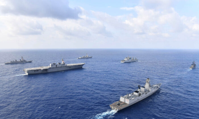 Naval vessels from the United States, Japan, India, and the Philippines conduct formation exercises and communication drills in the South China Sea, May 2019. (Japan Maritime Self-Defense Force/U.S. Navy)